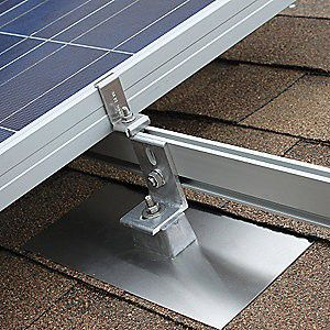 Solar panel roof mounting system with flashing